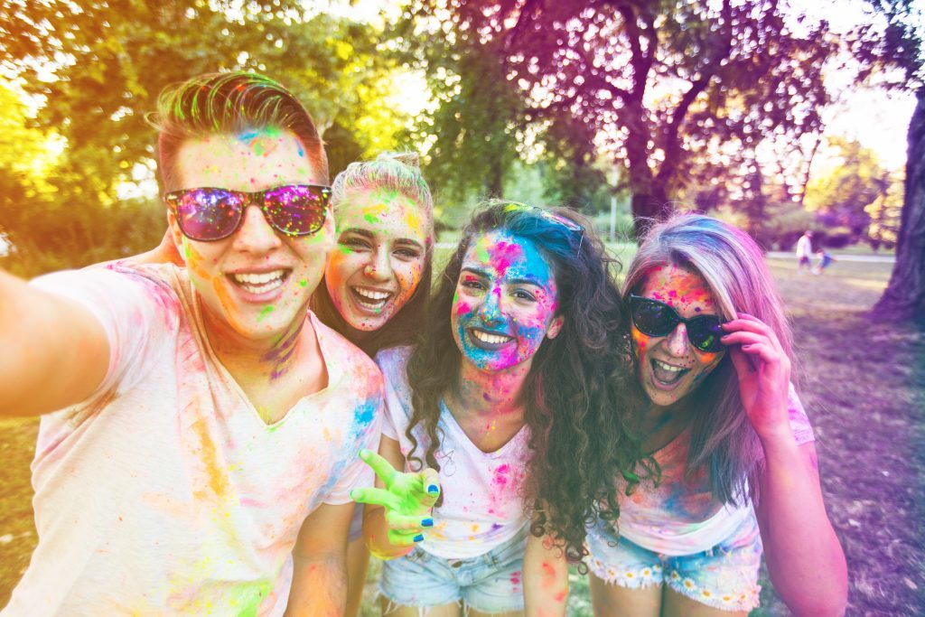 Teens enjoying holi festival