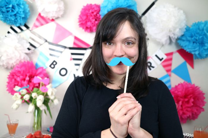 gender reveal photo booth with blue powder